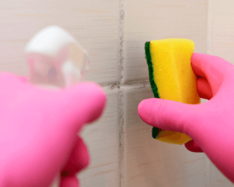 Cleaning Grout with Vinegar Mixture in a Spray Bottle